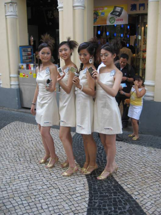 Girls modeling cell phones in Senado Square.